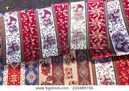 Colorful Fabrics And Other Folk Products At A Roadside Stall With Traditional Armenian Colors And Pa