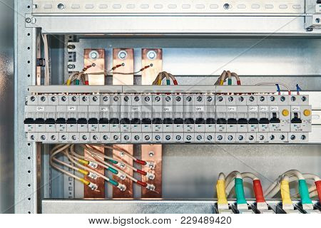 Modular Electrical Circuit Breakers And Differential Switches In Electrical Cabinet. Electrical Wire