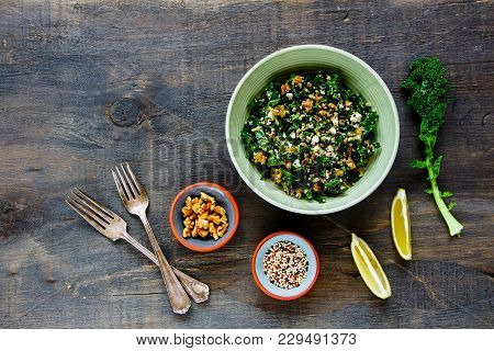 Ingredients For Making Raw Healthy Kale And Quinoa Salad With Feta Cheese And Walnut On Wooden Board