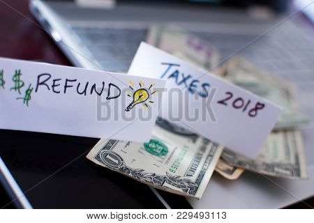 Getting A Tax Refund Conceptual Tax Return And Income Tax Credit Photography Background With Words T
