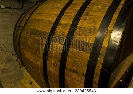Old Wooden Barrel Close Up. Natural Grunge Textured Barrel. Dark Surface With Old Natural Wooden Pat