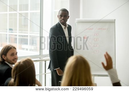 Business Audience Asking African American Presenter Speaker Questions At Training, Black Coach In Su