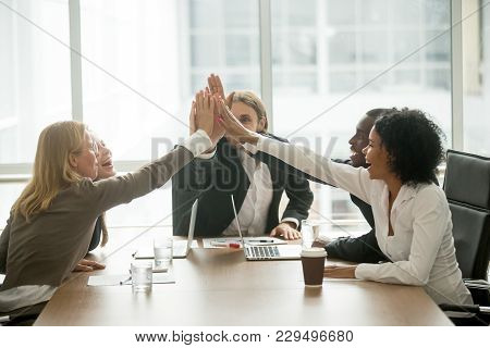 Happy Motivated Multiracial Team Giving High Five At Meeting, Diverse Group Of Colleagues Join Hands