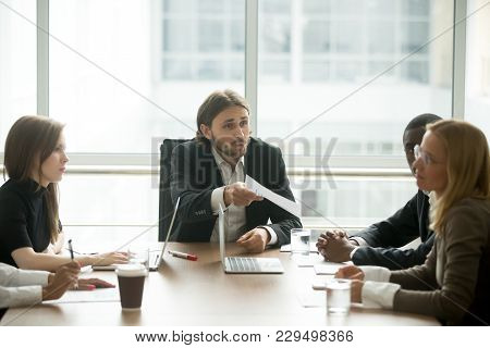 Angry Boss Reprimanding Female Employee For Bad Work Result Sitting At Conference Table, Male Ceo Sc