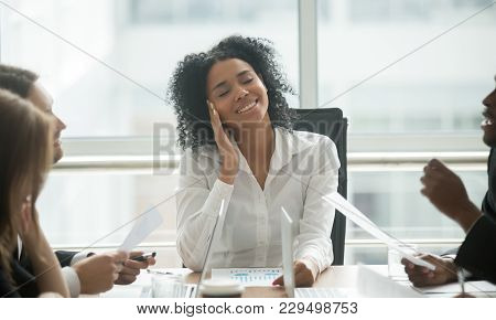 Absent-minded Distracted Black Businesswoman Dreaming Of Success And Happiness At Corporate Group Me