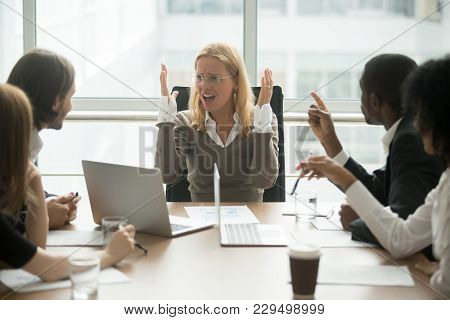Stressed Angry Businesswoman Arguing At Meeting With Diverse Male Colleagues, Woman Boss Team Leader