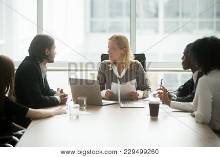 Woman Boss Discussing New Project Or Financial Report At Group Briefing With Diverse Employees, Seri
