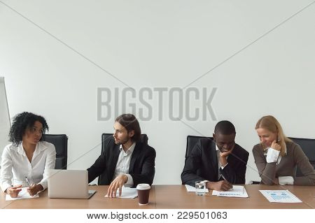 Diverse Business People Working Talking Sitting At Conference Table, African And Caucasian Employees