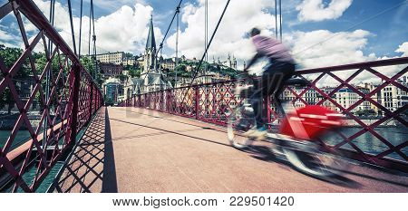 Panoramic View Of Bike On Red Footbridge, Lyon, France