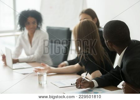 Multiracial Business Group Having Discussion At Office Meeting, African And Caucasian Colleagues Bra