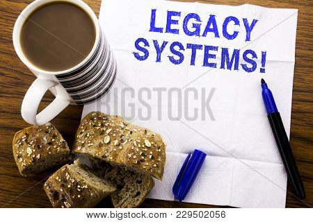 Handwritten Text Showing Legacy Systems. Business Concept For Upgrade Soa Application Written On Tis