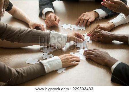Diverse Business People Helping In Assembling Puzzle, Cooperation In Decision Making, Team Support I