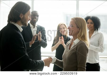 Boss Handshaking Employee Congratulating With Promotion While Diverse Colleagues Clapping Applauding