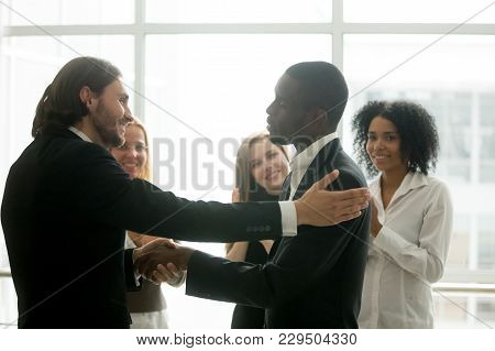 Company Boss Promoting African Male Employee With Handshake Showing Gratitude, Partnership Or Apprec