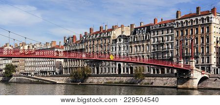 View Of Lyon With Saone River And Famous Red Footbridge