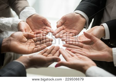 Diverse Multi-ethnic Business Team Members Join Helping Hands Group Together Palms Up As Concept Of