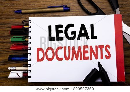 Handwritten Text Showing Legal Documents. Business Concept For Contract Document Written On Notebook