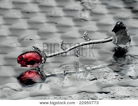 crystal flower lying on an iron table, wet from the rain. poster