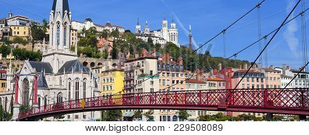 View Of Lyon City And Red Footbridge On Saone River And Church