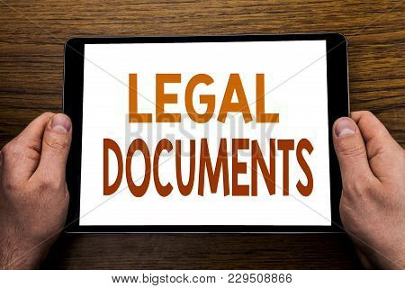 Hand Writing Text Caption Legal Documents. Business Concept For Contract Document Written Tablet Lap