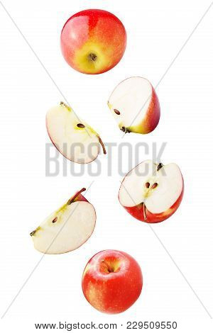 Isolated Falling Fruits. Falling Apple Fruit Isolated On White Background With Clipping Path As Pack
