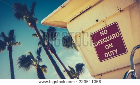 Retro Image Of A Lifeguard Station Or Tower On A Beach In California With Palm Trees