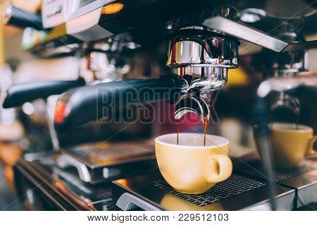 Professional Brewing - Coffee Bar Details. Espresso Coffee Pouring From Espresso Machine. Barista De