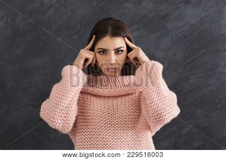 Portrait Of Young Woman Having Headache. Attractive Girl With Migraine Touching Her Head, Dark Backg