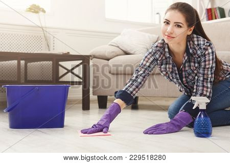 Smiling Woman Polishing Wooden Floor. Young Girl In Protective Gloves Washing Apartment, Spring Clea