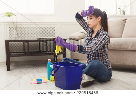 Young Woman Tired Of Spring Cleaning House, Washing Floor With Rag, Bucket And Detergents, Copy Spac