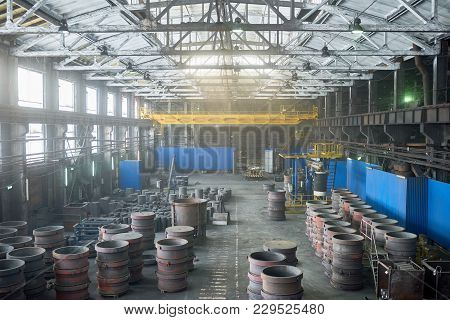 Interior Of Spacious Production Department Of Modern Plant Illuminated With Sunbeams Coming From Pan