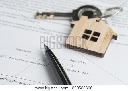 Pen On Sign Agreement Contract Paper Document With Key With Wooden House Key Chain, Real Estate Buy