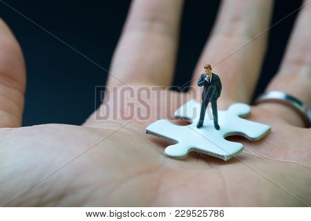 Business Success Strategy With Missing Jigsaw Key Person, Miniature People Businessman Thinking And