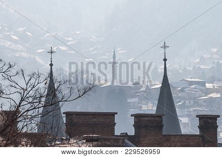 Minaret And Church Towers (steeples) On The Hills Of Sarajevo, Bosnia And Herzegovina. This City Is