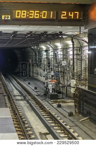 Tunnel In The Subway Illuminated By Bright Lights Spotlights With Rails And Sleepers Going Into The