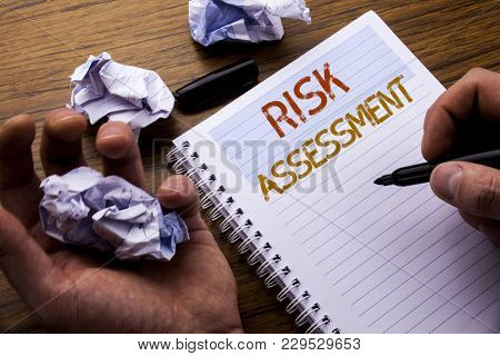 Word, Writing Risk Assessment. Concept For Safety Danger Analyze Written On Notebook Notepad Note Pa