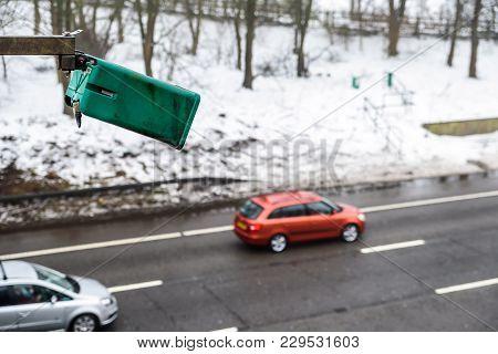 Winter Snowy Day View Of Average Speed Traffic Camera Over Uk Motorway.