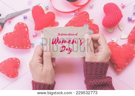 Woman Hand Holding Brown Paper With Writing Happy International Women's Day Message On The Paper Wit