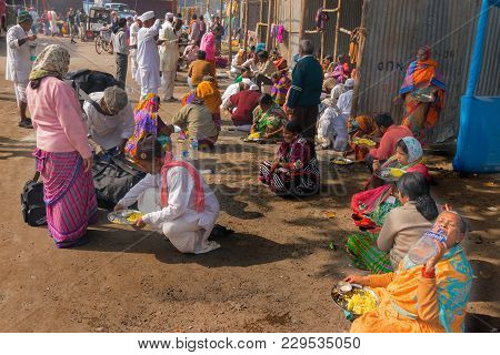 Kolkata, West Bengal , India - January 18th 2015 : A Seated Indian Male Selling Colorful Chappals (s
