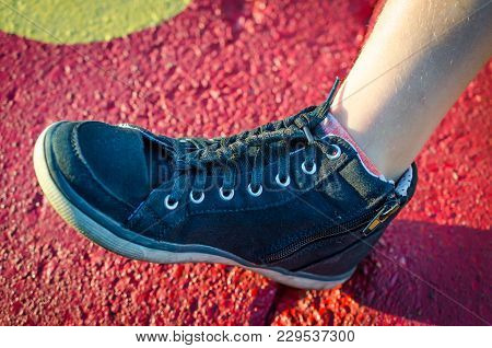 Shoelace Tied Into Braid. Fashion And Style With Benefit Of Shoe Lace That Does Not Dangle Or Get Lo