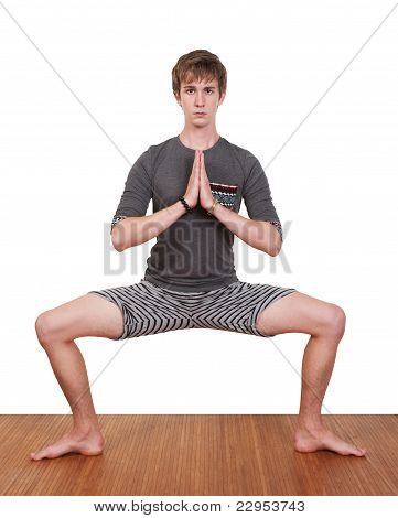 Young Man Practices Yoga