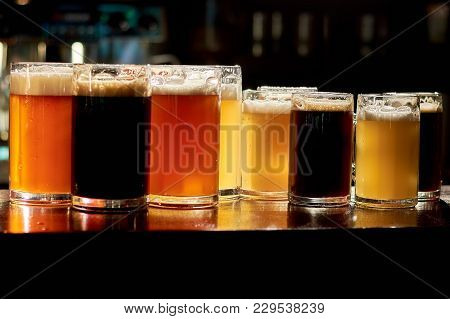 Different Sorts Of Beer In Bar. Variety Of Different Sorts Of Beers In Pub. Assorted Drinks For Tast