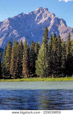 Bow River In Banff Alberta Canada With Bright Sunlight