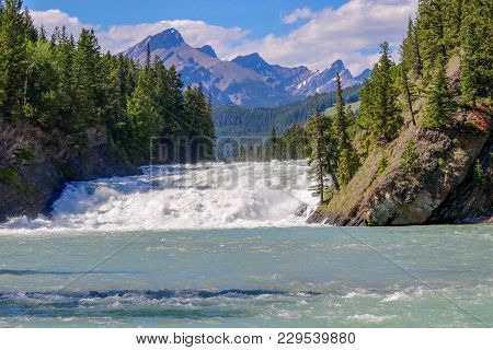Rushing Rapids On Bow River In Banff Alberta Canada