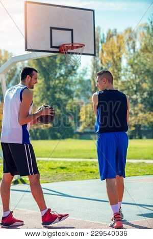 Two Street Basketball Players On The Basketball Court.