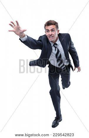 businessman runs forward stretching out his hand