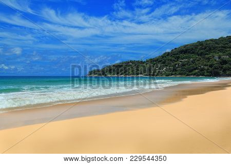 The Beach In The Warm Sea. Waves With Foam On The Sand. Beach Without People. Yellow Sand And Blue S