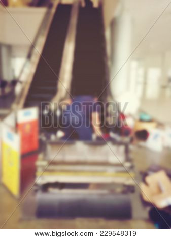Blurred Image Of Professional Technician Mechanical People Assembly Part Of Escalator. Install Works