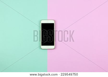Black Blank Smart Phone Screen On Colored Background. Minimal Concept. Flat Lay. Top View.