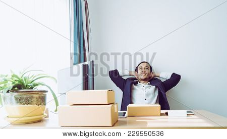 Business Man Is Sitting Relaxing On Office Desk